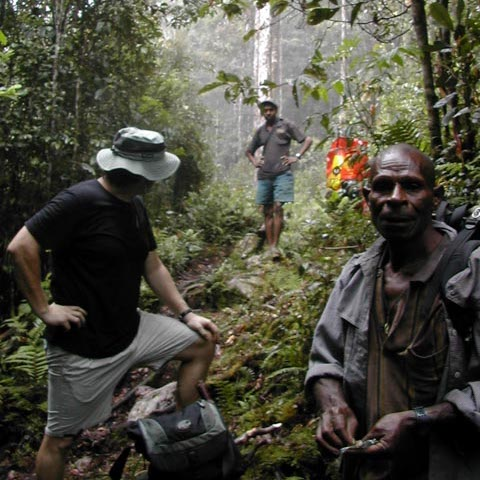 Here I am while the men take a smoke break.  You can see the guy rolling his tobacco in a torn piece of newspaper.  I am looking, somewhat impatiently it seems, at my man Raymond Kuaru from Bukitu village.  We worked together nearly 15 years.