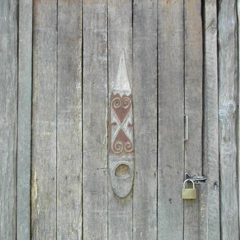 Telefomin doorboard reduced to a decorative motif on a more modern village house, West Sepik Province, Papua New Guinea, circa 2004/5.