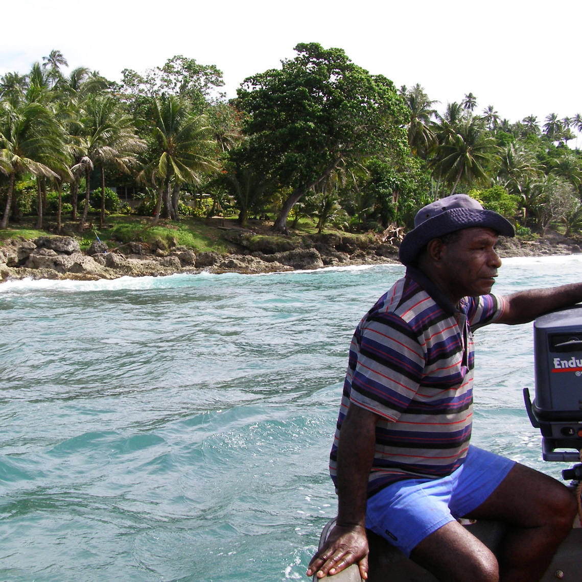 My good friend and long-time field collector Jerry Kudud idling just off the rocks in front of my old house, hidden in the trees, on Wewak Point, East Sepik Province, Papua New Guinea, circa 2005.