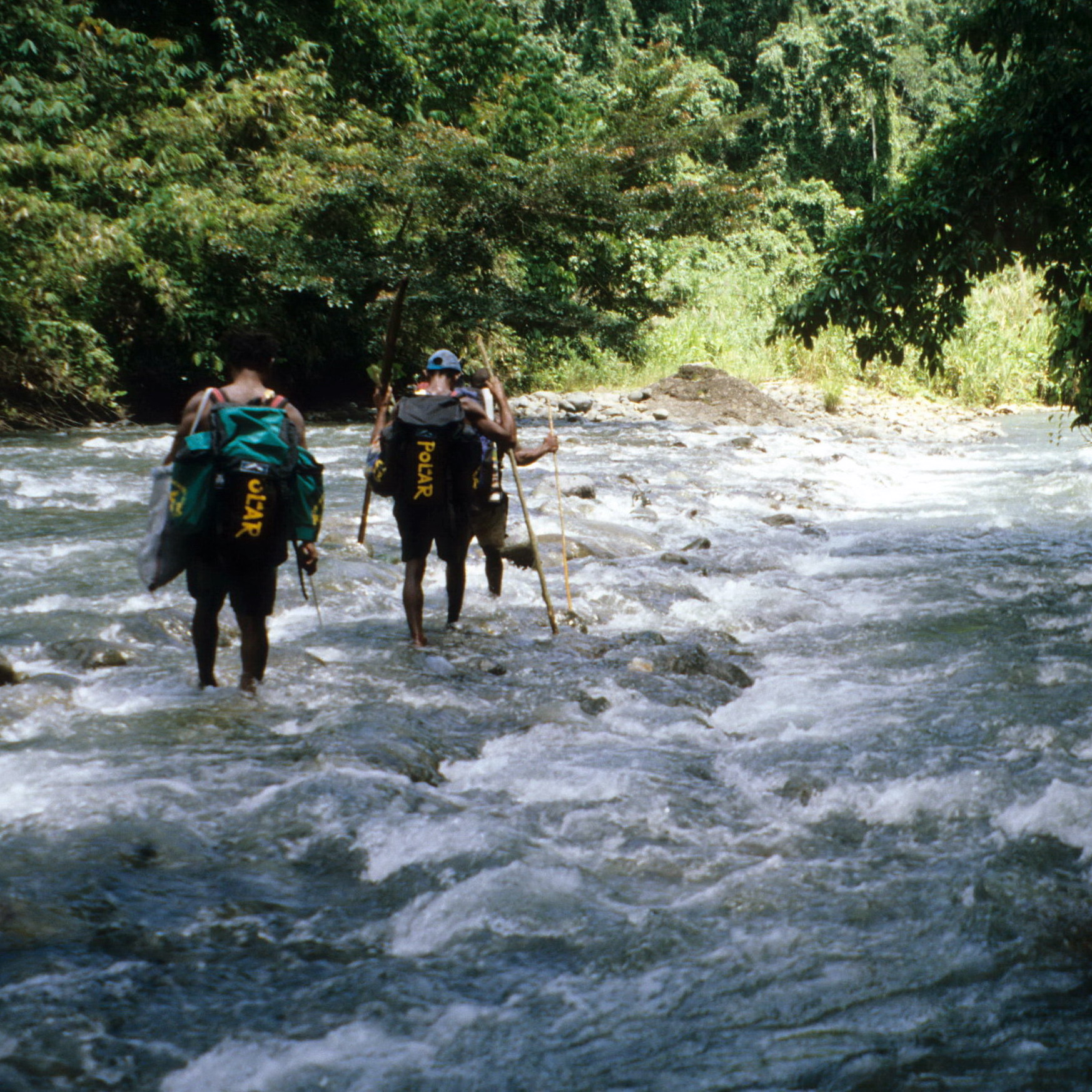 Men Crossing Whitewater River, New Guinea Field Collecting for Oceanic Art