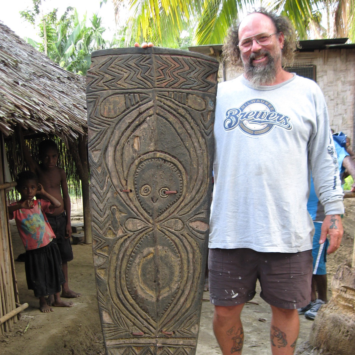 Jim Sanders with Bongos Arkosame Shield, New Guinea Art, Oceanic Art, South Pacific Art, Tribal Art